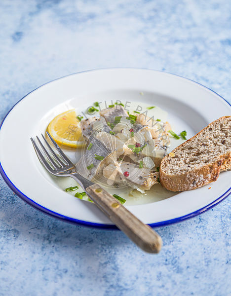Marrinated herring in onion and herbs