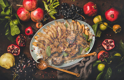 Turkish meat dish with roasted lamb chops, quince, rice pilav