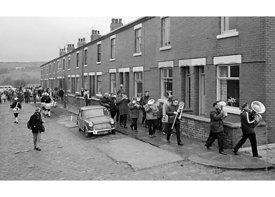 #77113,  The 'Nutters' Dance', Bacup, Lancashire,  1973.  On Easter Saturday every year the 'Coconut Dancers' gather at one b...