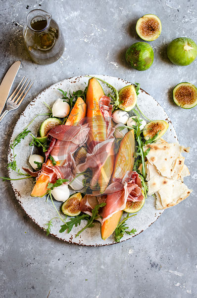 Melon and ham salad with fig and mozzarella