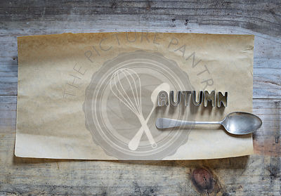 'Autumn' written in cookie cutter on brown paper backgroun