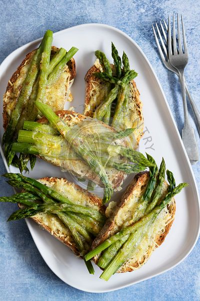 Grilled asparagus and cheese on sourdough bread.