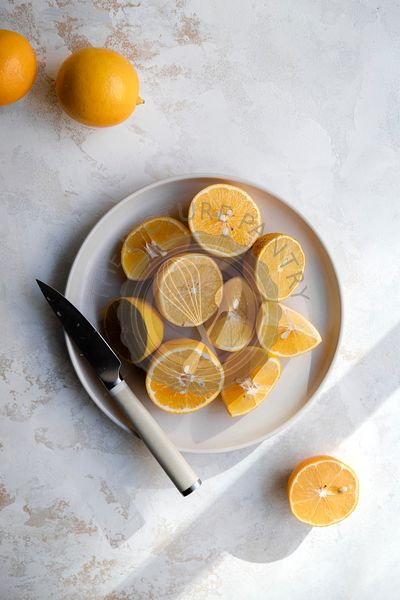 Sliced meyer lemons on a plate