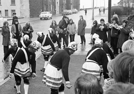 #77099,  The 'Nutters' Dance', Bacup, Lancashire,  1973.  On Easter Saturday every year the 'Coconut Dancers' gather at one b...