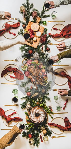 Flat-lay of Peoples hands with wine in glasses celebrating Christmas