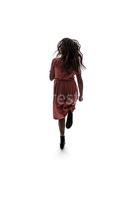 A semi-silhouette of a 1940's child running – shot from mid level.
