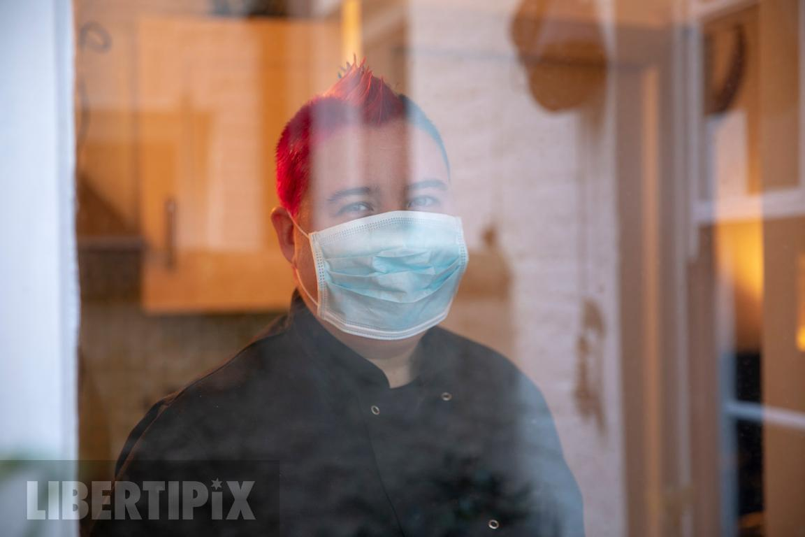 A non-binary person wearing a mask in Covid times-LGBTQ+ stock photography