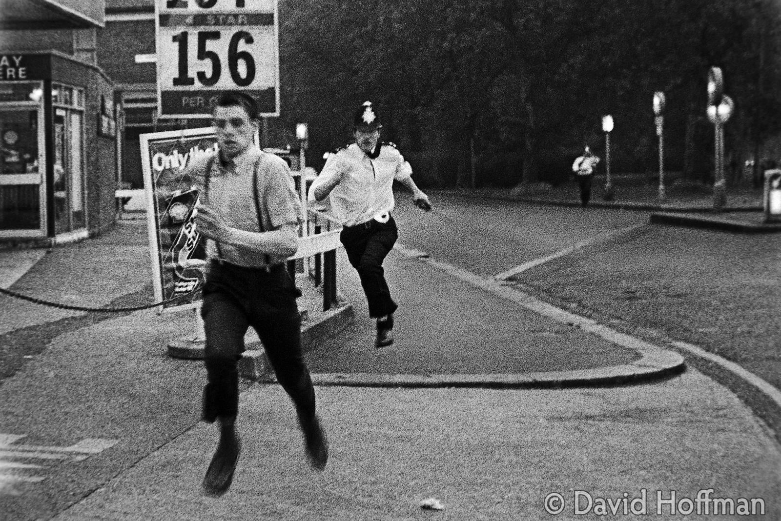 Police chase skinhead during rioting in Wood Green, July 1981.