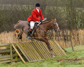 Chris Edwards jumping a hunt jump at Peakes - The Fitzwilliam Hunt visit the Cottesmore at Burrough House