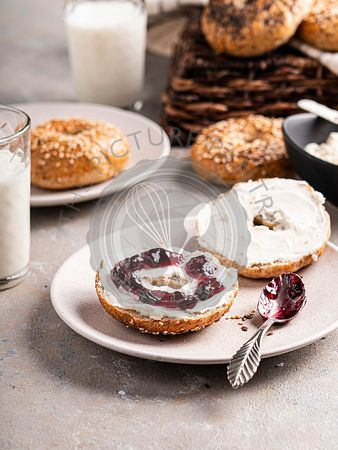 Bagel with cream cheese and jam