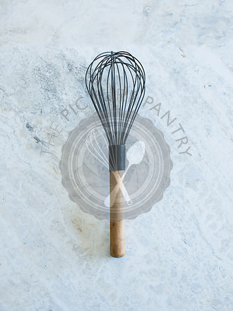 Whisk on grey background