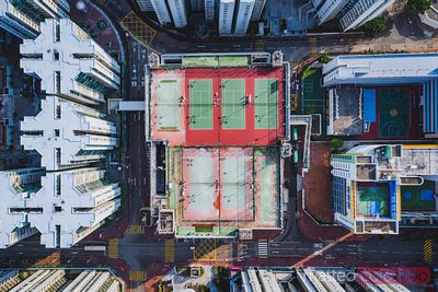 Aerial of tennis court among high rise buildings, Hong Kong