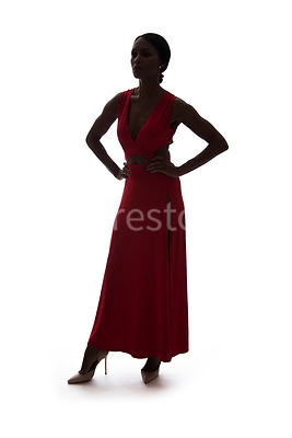 A silhouette, of a woman in a red dress – shot from mid level.