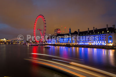 Colourful London Eye and County Hall from Westminster Bridge at night