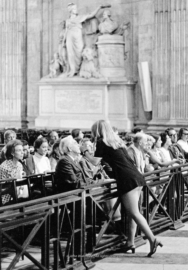 #057721   A tour guide and her group visiting St Paul's Cathedral.  It was the days of mini-skirts but showing this much bare...
