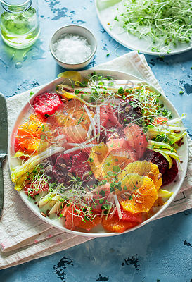Citrus salad with endive, clover sprouts and sunfloer seeds