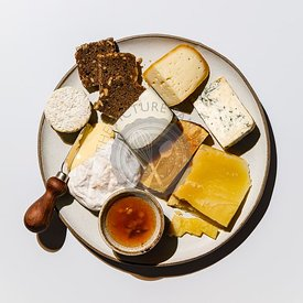 Cheese Plate with different types of cheese Snack assortment