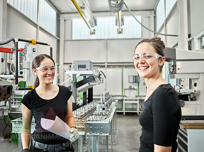 Two woman working on a machine