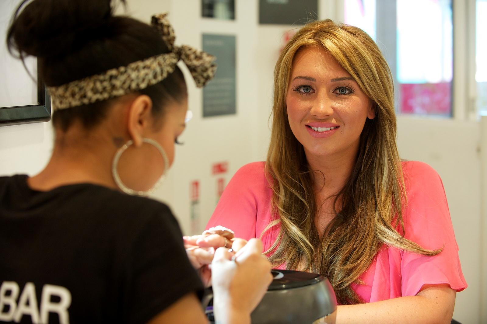 Lauren Goodger (star of The Only Way Is Essex) at the offical opening of the Regis Hair and Beauty nail bar at Debenhams in R...
