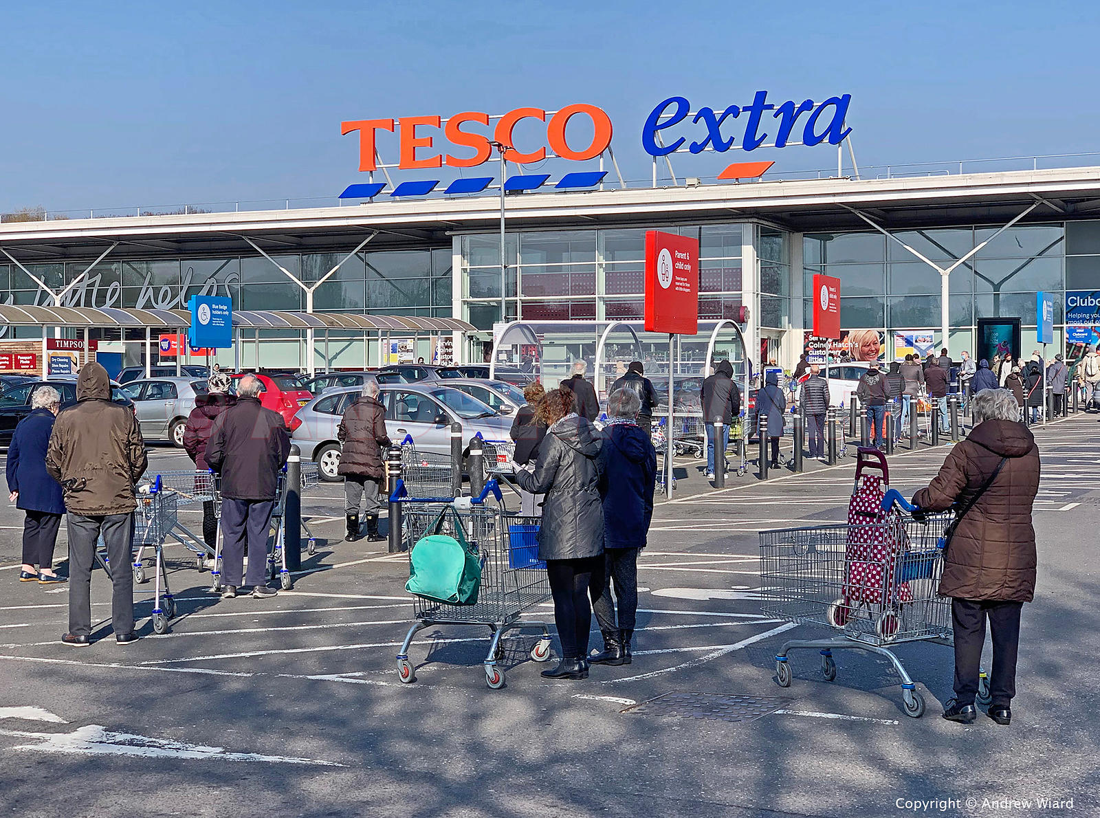 England, UK. 27.3.2020. London. Tescos, Colney Hatch Lane. Early morning supermarket queue for over seventies, six feet apart...