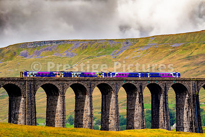 Northern Rail diesel train crossing the Ribblehead viaduct