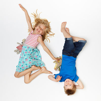 Boy & Girl head to tail on a white background
