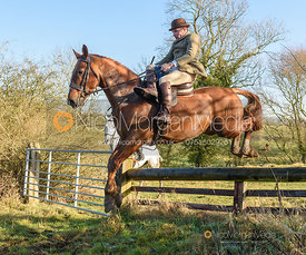 Bruce McKim jumping a fence near Knossington. The Cottesmore Hunt at Priory Farm 21/1