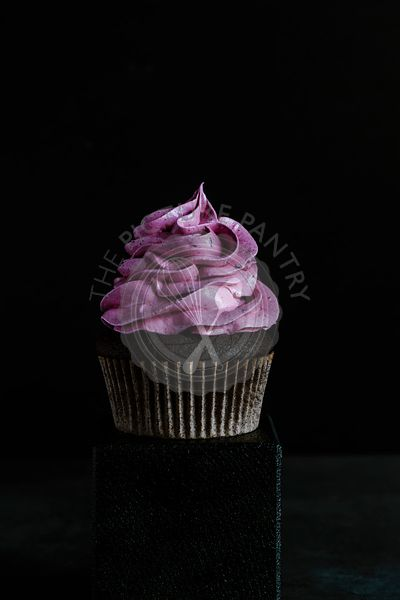 Chocolate cupcake with black currant marshmallow frosting.