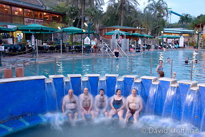Family members relax in the thermal baths by the Sea of Galilee Israel.