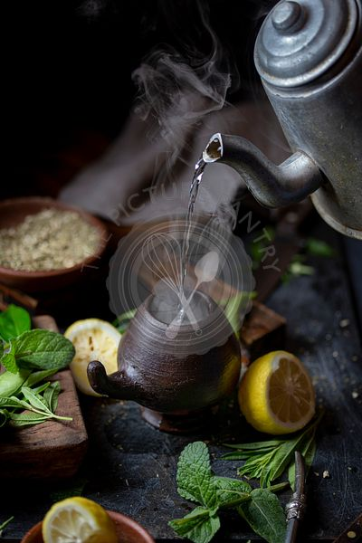 Latin American hot drink yerba mate in clay cup, herbs amd lemon