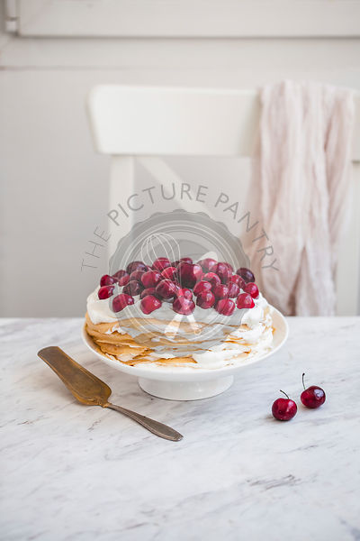 Crepes stack with whipped cream and cherries