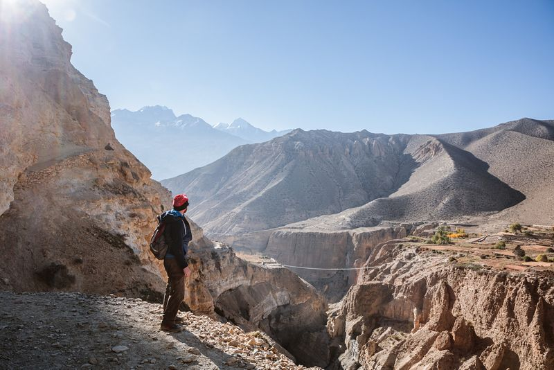 Hiker on a track, Upper Mustang region, Nepal