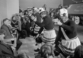 #77121,  The 'Nutters' Dance', Bacup, Lancashire,  1973.  On Easter Saturday every year the 'Coconut Dancers' gather at one b...