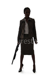 A tough woman, standing, holding shotgun, in silhouette – shot from eye level.