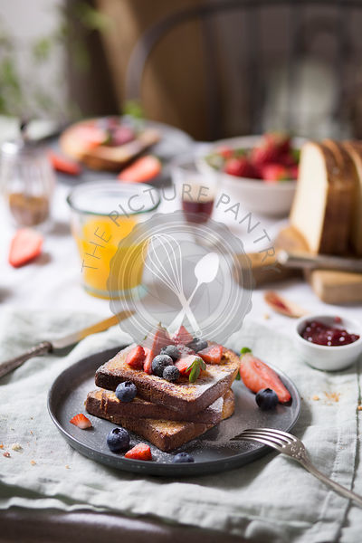 French toast with fresh fruit on the breakfast table