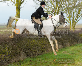 James Holliday jumping a hedge at Sheepwash