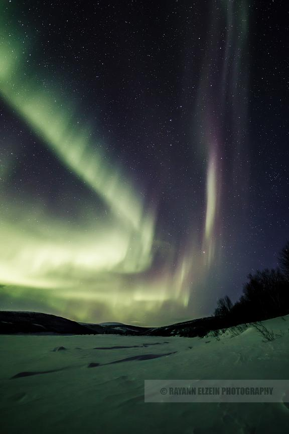 Powerful green and purple display of the northern lights in Utsjoki, Finnish Lapland