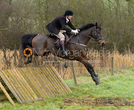 Max Chenery jumping a hunt jump at Peakes - The Fitzwilliam Hunt visit the Cottesmore at Burrough House
