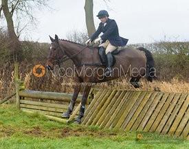 Harriet Walker jumping a hunt jump after the meet