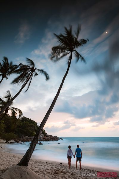 Tourist couple on tropical beach at dawn, Ko Samui