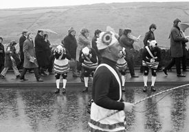 #77101,  The 'Nutters' Dance', Bacup, Lancashire,  1973.  On Easter Saturday every year the 'Coconut Dancers' gather at one b...