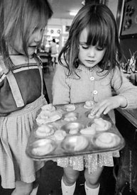 #77331,  Girls with a baking tray, Vittoria Primary School, Islington, London.  1970.