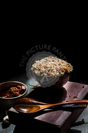 Vegetable Fried rice against a dark background with copy space