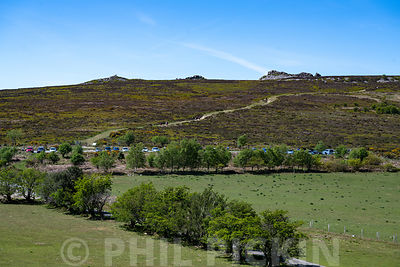 Cars parked in the Stiperstones National Nature Reserve on a hoit sunny day shortly after lockdown measures have been relaxed.