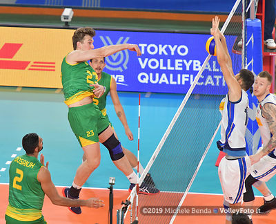 Roberto RUSSO, #15 of Italy, blocks the ball attacked by, James WEIR, #23 of Australia