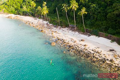 Aerial of woman kayaking near the beach, Ko Samui, Thailand