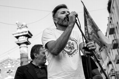 Riccardo Gatti, Head of Mission in Italia, of Spanish NGO Proactiva Open Arms, delivering a speech at the demonstration.