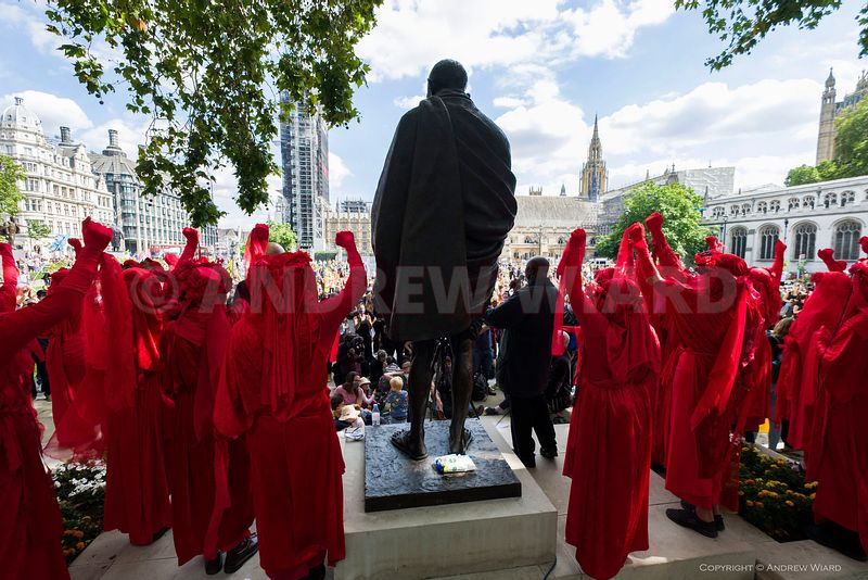 The Red Brigade at the Ghandi statue, as Extinction Rebellion launch ten days of protest by blocking Parliament Square, Londo...
