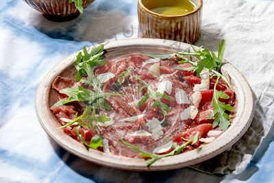 Beef carpaccio, cheese and arugula