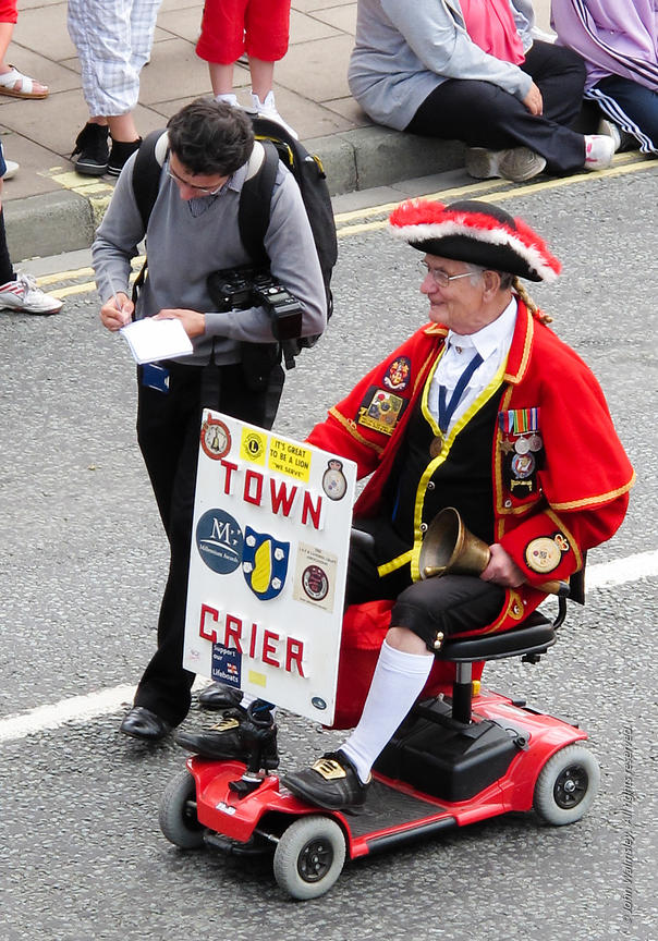 #72018  The Town Crier gives his details to a photographer from the local paper, annual carnival to raise money for charity, ...